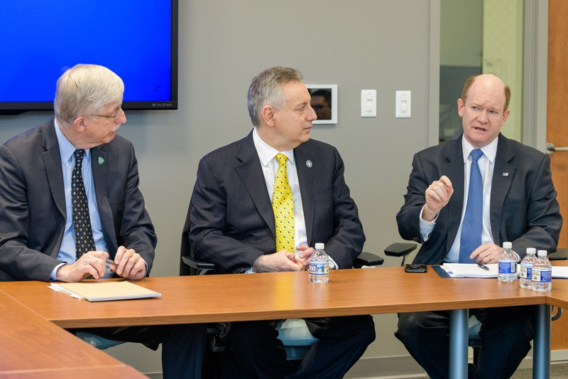 U.S. Sen. Chris Coons (right) makes a point during the discussion that Coons, NIH Director Francis Collins (left) and UD President Dennis Assanis had with students.