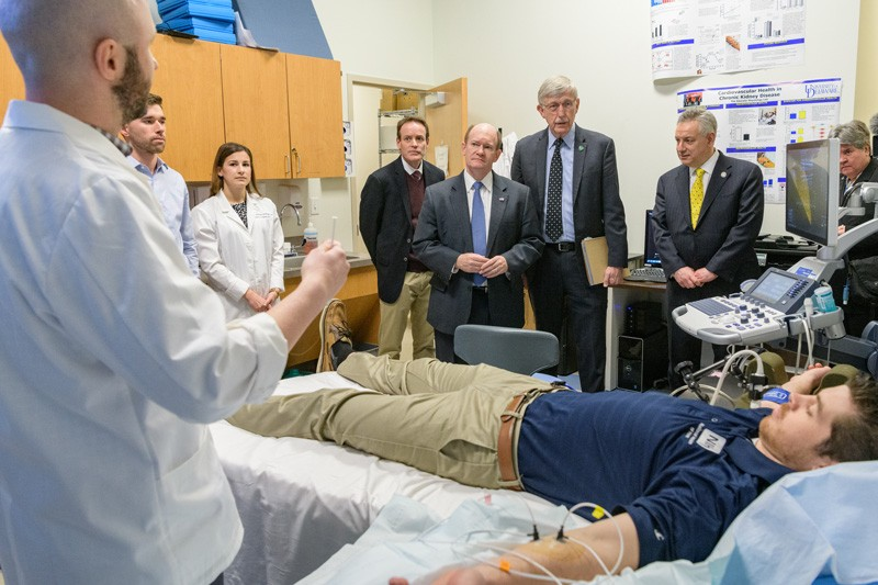 One of the labs NIH Director Francis Collins and others visited was the Vascular Physiology Lab directed by Prof. David Edwards, who studies vascular function. Jordan Patik (far left), a postdoctoral fellow, explains part of the research process.